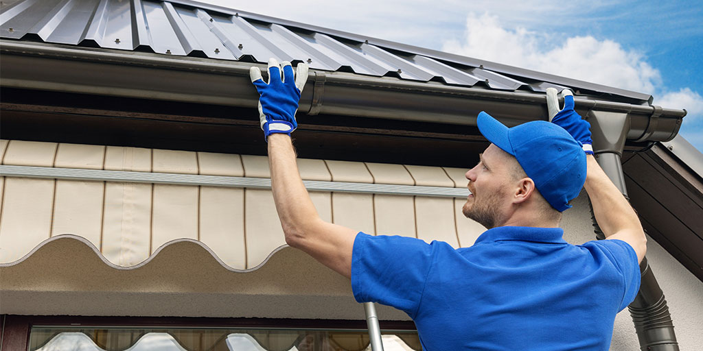 Worker checking gutters