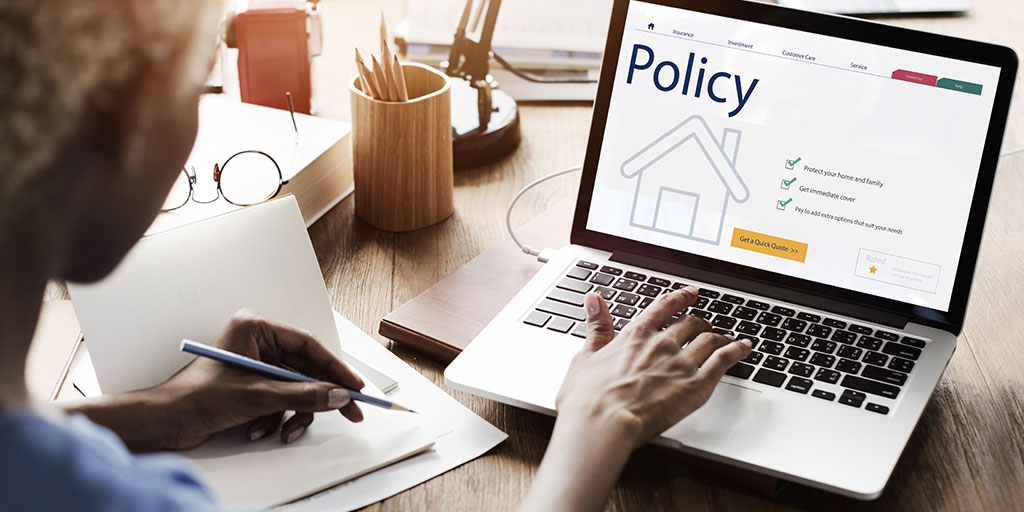 Woman looking at insurance policy online