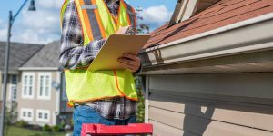 Roof inspector with a clip board