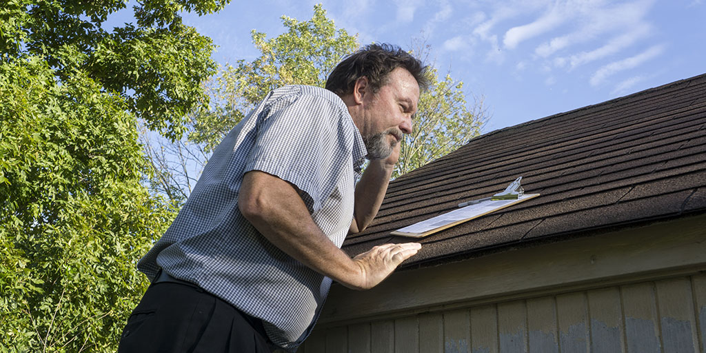 Roof inspector on roof